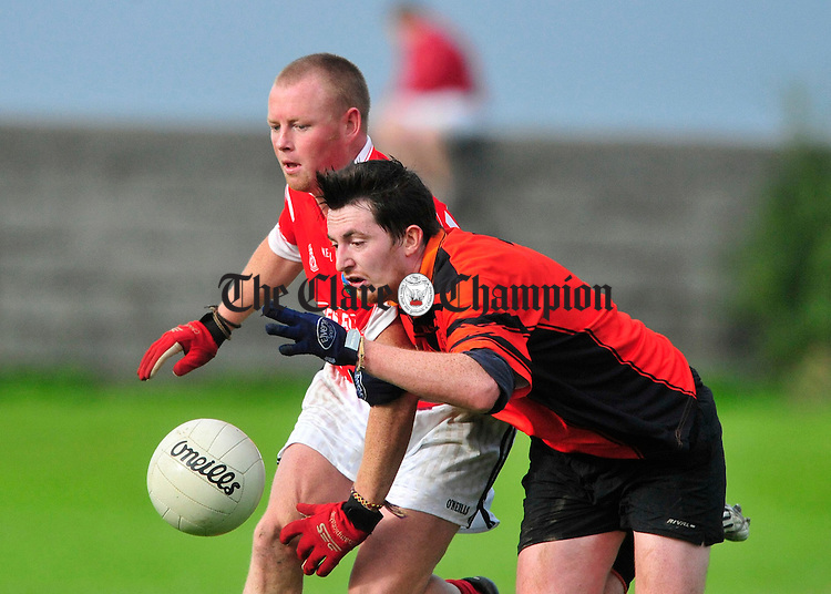 Corofin's Jason Tierney battles for posession with Ballyvaughan's Setanta Moran. Photograph by Declan Monaghan