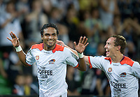 MELBOURNE, AUSTRALIA - DECEMBER 03: Jean Carlos Solorzano of the Roar celebrates his goal during the round 17 A-League match between the Melbourne Victory and the Brisbane Roar at AAMI Park on December 3, 2010 in Melbourne, Australia. (Photo by Sydney Low / Asterisk Images)