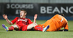 Stevie Smith collides with keeper Jamie MacDonald