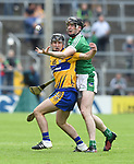 Ian Galvin of Clare in action against Declan Hannon of Limerick during their Munster Championship semi-final at Thurles.  Photograph by John Kelly.