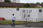 """© Joel Goodman - 07973 332324 . 28/08/2015 . Salford , UK . RIP PM graffiti on hoardings on Churchill Way , near to St Paul's CE Church . The funeral of Paul Massey at St Paul's CE Church in Salford . Massey , known as Salford's """" Mr Big """" , was shot dead at his home in Salford last month . Photo credit : Joel Goodman"""