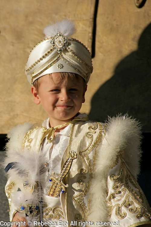 Young Turkish boy in his celebratory circumcision outfit