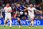 Osako Yuya of Japan (C) fights for the ball with Omid Ebrahimi Zarandini of Iran (R) and Ehsan Haji Safi of Iran (L) during the AFC Asian Cup UAE 2019 Semi Finals match between I.R. Iran (IRN) and Japan (JPN) at Hazza Bin Zayed Stadium  on 28 January 2019 in Al Alin, United Arab Emirates. Photo by Marcio Rodrigo Machado / Power Sport Images