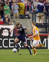 New England Revolution defender Pat Phelan (28) accelerates away from Houston Dynamo defender Andrew Hainault (31). The New England Revolution defeated Houston Dynamo, 1-0, at Gillette Stadium on August 14, 2010.