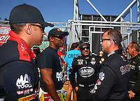 Aug. 3, 2014; Kent, WA, USA; NHRA top fuel dragster drivers (L-R) J.R. Todd , Antron Brown , Khalid Albalooshi and Steve Torrence talk during the Northwest Nationals at Pacific Raceways. Mandatory Credit: Mark J. Rebilas-