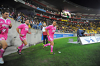 The match officials run out for the second half during the ITM Cup rugby union final between the Wellington Lions and Canterbury at Westpac Stadium, Wellington, New Zealand on Saturday, 26 October 2013. Photo: Dave Lintott / lintottphoto.co.nz
