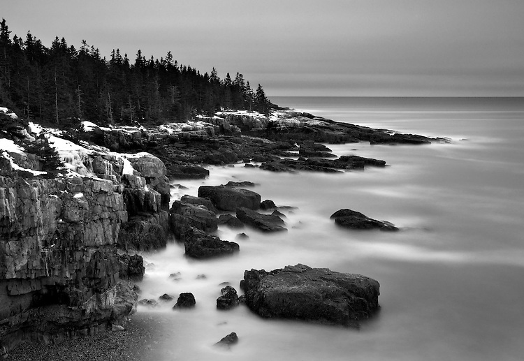 A storm and waves roll into the Schoodic Peninsula's rugged western coastline in Acadia National Park, Maine, USA