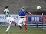 Paul McMullan of Celtic with Jamie Mills of Rangers