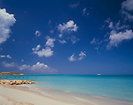 Antigua, West Indies  <br /> White sand beach and blue waters of Dickinson Bay with Corbinson point in the distance