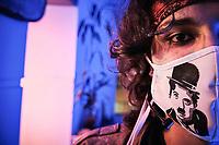 BOGOTA - COLOMBIA, 11-07-2020: Uno de los mienmbros del grupo de teatro Buen Viaje Teatro de Cajicá, Colombia, posa con una máscara de Charles Chaplin en la sala de la casa adaptada para la presentación virtual el día 109 de la cuarentena total en el territorio colombiano causada por la pandemia  del Coronavirus, COVID-19. Esta ha sido la manera de mantenerse activos y buscar algún ingreso de dinero desde la suspensión de toda actividad en Colombia. / A member of the theater group Buen Viaje Teatro in Cajicá, Colombia, pose with a mask of Charles Chaplin in the living room of the house adapted for the virtual presentation on day 109 of the total quarantine in Colombian territory caused by the Coronavirus pandemic, COVID-19. This has been the way to stay active and seek some money income since the suspension of all activity in Colombia.. Photo: VizzorImage / Alejandro Avendaño / Cont