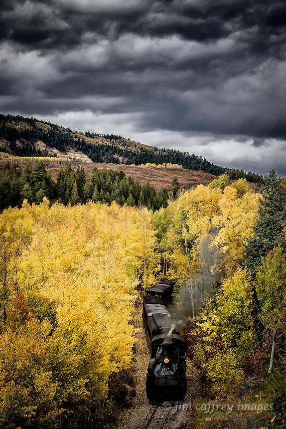 The Cumbres-Toltec narrow-guage train moves through a stand of autumn aspens in the San Juan Mountains near the Colorado/New Mexico border.
