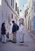 Tunisia.  Tunis Medina.  Women Talking, Modern and Traditional Clothing Styles.