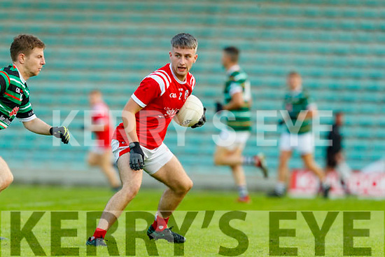 Chris O'Donoghue, East Kerry in action against Ian McCarthy, St. Brendan's Board during the Kerry County Senior Football Championship Semi-Final match between East Kerry and St Brendan's at Austin Stack Park in Tralee, Kerry.