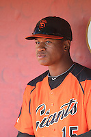 Jalen Miller (15) of the AZL Giants in the dugout before a game against the AZL Angels at Tempe Diablo Stadium on July 6, 2015 in Tempe, Arizona. Angels defeated Giants, 3-1. (Larry Goren/Four Seam Images)
