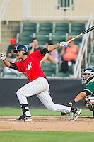 Nick Basto (27) of the Kannapolis Intimidators follows through on his swing against the Greensboro Grasshoppers at CMC-Northeast Stadium on July 13, 2013 in Kannapolis, North Carolina.  The Intimidators defeated the Grasshoppers 7-5.   (Brian Westerholt/Four Seam Images)