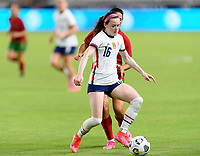HOUSTON, TX - JUNE 10: Rose Lavelle #16 of the United States brings the ball up the field during a game between Portugal and USWNT at BBVA Stadium on June 10, 2021 in Houston, Texas.