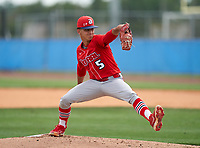 Doral Academy Firebirds pitcher Evan Demurias (5) during the IMG National Classic on March 29, 2021 at IMG Academy in Bradenton, Florida.  (Mike Janes/Four Seam Images)