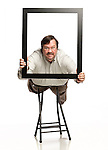 Wayne Andrews holds a picture frame in Oxford, Miss. on Tuesday, August 30, 2011.