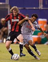 The MetroStars' Eddie Gaven battles Arturo Alvarez of FC Dallas for the ball. The MetroStars defeated FC Dallas  3 - 2 at Giant's Stadium, East Rutherford, NJ, on July 27, 2005.