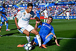 Achraf Hakimi of Real Madrid (L) fights for the ball with Mauro Wilney Arambarri Rosa of Getafe CF (R)  during the La Liga 2017-18 match between Getafe CF and Real Madrid at Coliseum Alfonso Perez on 14 October 2017 in Getafe, Spain. Photo by Diego Gonzalez / Power Sport Images
