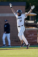 Third baseman Noah Rabon (17) of the University of South Carolina Upstate Spartans celebrates his sixth-inning, two-run home run as he crosses the plate in a game against the University of Toledo Rockets on Friday, February 19, 2021, at Cleveland S. Harley Park in Spartanburg, South Carolina. Upstate won, 14-2. (Tom Priddy/Four Seam Images)