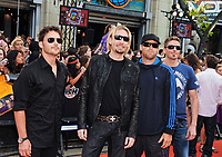 23 December 2020 - Canadian rock band Nickelback (Ryan Peake, Chad Kroeger, Mike Kroeger and Daniel Adair) parody their hit 'Photograph' for a new Google Photo advertisement. File Photo: 2009 MuchMusic Video Awards, Toronto, Ontario, Canada. Photo Credit: Brent Perniac/AdMedia