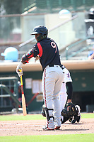 Olivier Basabe (9) of the Lake Elsinore Storm bats against the Inland Empire 66ers at San Manuel Stadium on June 5, 2019 in San Bernardino, California. (Larry Goren/Four Seam Images)