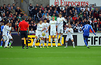 Saturday, 03 November 2012<br /> Pictured : Oscar of Chelsea takes a free kick (R), Angel Rangel, Ki sung Yueng, Garry Monk, Michu, Leon Britton, Pablo Hernandez, Ashley Willams<br /> Re: Barclays Premier League, Swansea City FC v Chelsea at the Liberty Stadium, south Wales.<br /> Garry Monk of Swansea