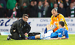 St Johnstone v Celtic...07.05.14    SPFL<br /> Gary Miller lies injured<br /> Picture by Graeme Hart.<br /> Copyright Perthshire Picture Agency<br /> Tel: 01738 623350  Mobile: 07990 594431