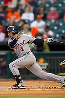 Detroit Tigers second baseman Omar Infante (4) follows through on his swing during the MLB baseball game against the Houston Astros on May 3, 2013 at Minute Maid Park in Houston, Texas. Detroit defeated Houston 4-3. (Andrew Woolley/Four Seam Images).