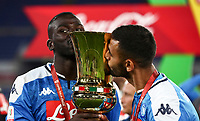 Napoli's Kalidou Koulibaly and Faouzi Ghoulam kiss the trophy at the end of the Italian Cup football final match between Napoli and Juventus at Rome's Olympic stadium, with closed doors, June 17, 2020. Napoli won 4-2 at the end of a penalty shootout following a scoreless draw.<br /> UPDATE IMAGES PRESS/Isabella Bonotto