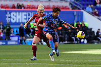 HARRISON, NJ - MARCH 08: Mina Tanaka #15 of Japan is defended by Millie Bright #6 of England during a game between England and Japan at Red Bull Arena on March 08, 2020 in Harrison, New Jersey.