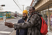 NDP leader Jagmeet Singh takes a selfie with a passerby as he visits Alma in the riding of Lac St-Jean on October 10, 2017.<br /> <br /> PHOTO :  Francis Vachon - Agence Quebec Presse