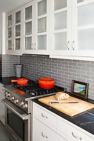 Red pans on the gas cooker
