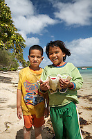 Children playing with Clam Shell in Tonga