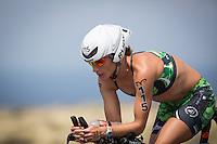 Amanda Stevens on the bike at the 2013 Ironman World Championship in Kailua-Kona, Hawaii on October 12, 2013.
