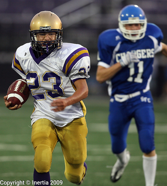 SIOUX FALLS, SD - SEPTEMBER 11: Branden LaBatte #23 of Flandreau picks up yardage as  Courtney Ecklund #11 of Sioux Falls Christian pursues in the first quarter of the Chargers home opener at the USF Athletic Complex. (Photo by Dave Eggen/Inertia).