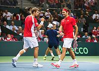 Switserland, Genève, September 19, 2015, Tennis,   Davis Cup, Switserland-Netherlands, Doubles: Swiss team Chiudinelli/Federer (R)<br /> Photo: Tennisimages/Henk Koster