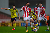21st November 2020; Bet365 Stadium, Stoke, Staffordshire, England; English Football League Championship Football, Stoke City versus Huddersfield Town; Steven Fletcher of Stoke City passes the ball