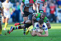 Jean-Marcel Buttin of ASM Clermont Auvergne  is tackled by Ugo Monye of Harlequins during the Heineken Cup Round 5 match between Harlequins and ASM Clermont Auvergne at the Twickenham Stoop on Saturday 11th January 2014 (Photo by Rob Munro)