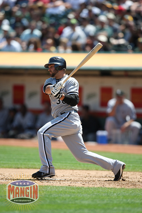 OAKLAND, CA - AUGUST 16:  Nick Swisher of the Chicago White Sox bats during the game against the Oakland Athletics at the McAfee Coliseum in Oakland, California on August 16, 2008.  The White Sox defeated the Athletics 2-1.  Photo by Brad Mangin