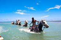Chukka Caribbean adventures, Jamaica. Family riding horses in the ocean. Jamaica Tourism.