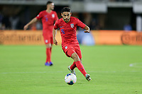 WASHINGTON, D.C. - OCTOBER 11: Cristian Roldan #15 of the United States dribbles with the ball during their Nations League game versus Cuba at Audi Field, on October 11, 2019 in Washington D.C.