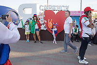 """SARANSK, RUSSIA - June 25, 2018: Russia fans pose with a """"I love Saransk"""" in Millennium Square in Saransk before the 2018 FIFA World Cup group stage match between Iran and Portugal at Mordovia Arena."""