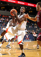 Nov 6, 2010; Charlottesville, VA, USA; Virginia Cavaliers g KT Harrell (24) grabs a rebound Saturday afternoon in exhibition action at John Paul Jones Arena. The Virginia men's basketball team recorded an 82-50 victory over Roanoke College.