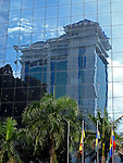 Reflections of a building in a glass facade.