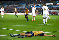 Alexis Sanchez of Arsenal lies frustrated after a missed chance during the Barclays Premier League match between Swansea City and Arsenal played at The Liberty Stadium, Swansea on October 31st 2015