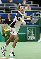 18-02-2006,Rotterdam, ABNAMROWTT , Tim Henman in action against LLodra