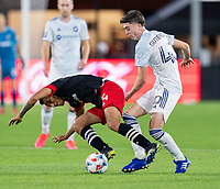 WASHINGTON, DC - MAY 13: Andy Najar #14 of D.C. United is fouled by Brian Gutierrez #40 of Chicago Fire FC during a game between Chicago Fire FC and D.C. United at Audi FIeld on May 13, 2021 in Washington, DC.