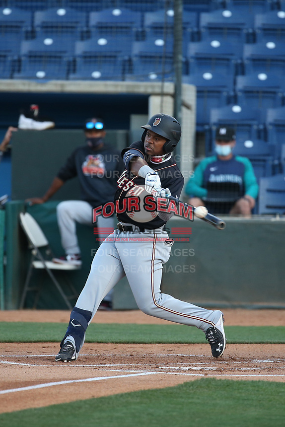 Alberto Rodriguez (45) of the Modesto Nuts bats against the Rancho Cucamonga Quakes at Loan Mart Field on May 12, 2021 in Rancho Cucamonga, California. (Larry Goren/Four Seam Images)